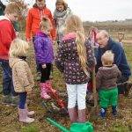 Chatteris Mayor Councillor Bill Haggata with children planting a tree.